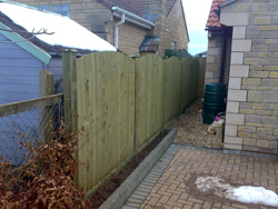 A photo after new installation of Jackson's convex feather board fence system with 25 year guarantee