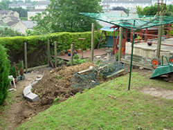 A photo before of a sloped garden